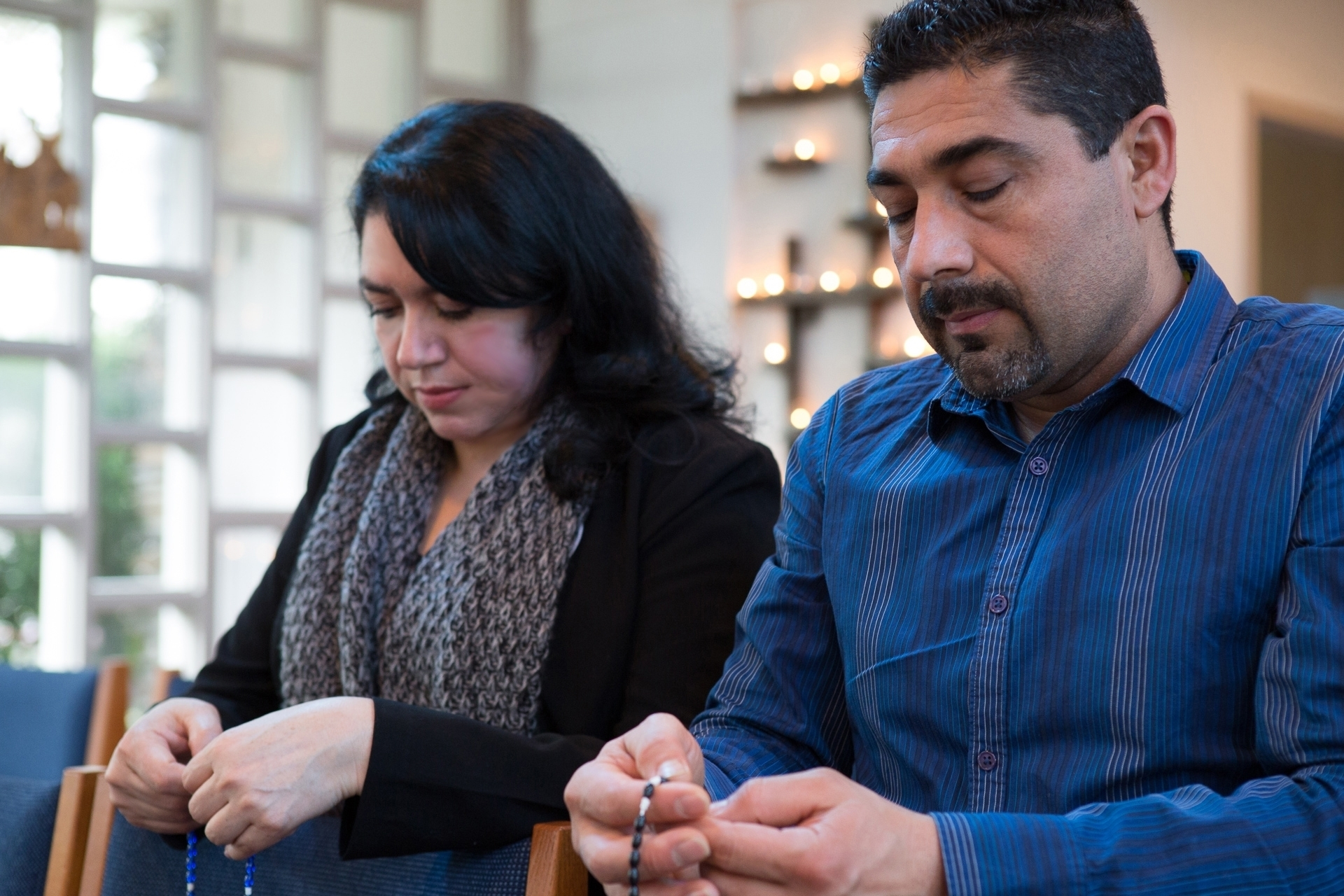 Hispanic man women couple mass praying rosary diversity Palisades Chapel retreat center