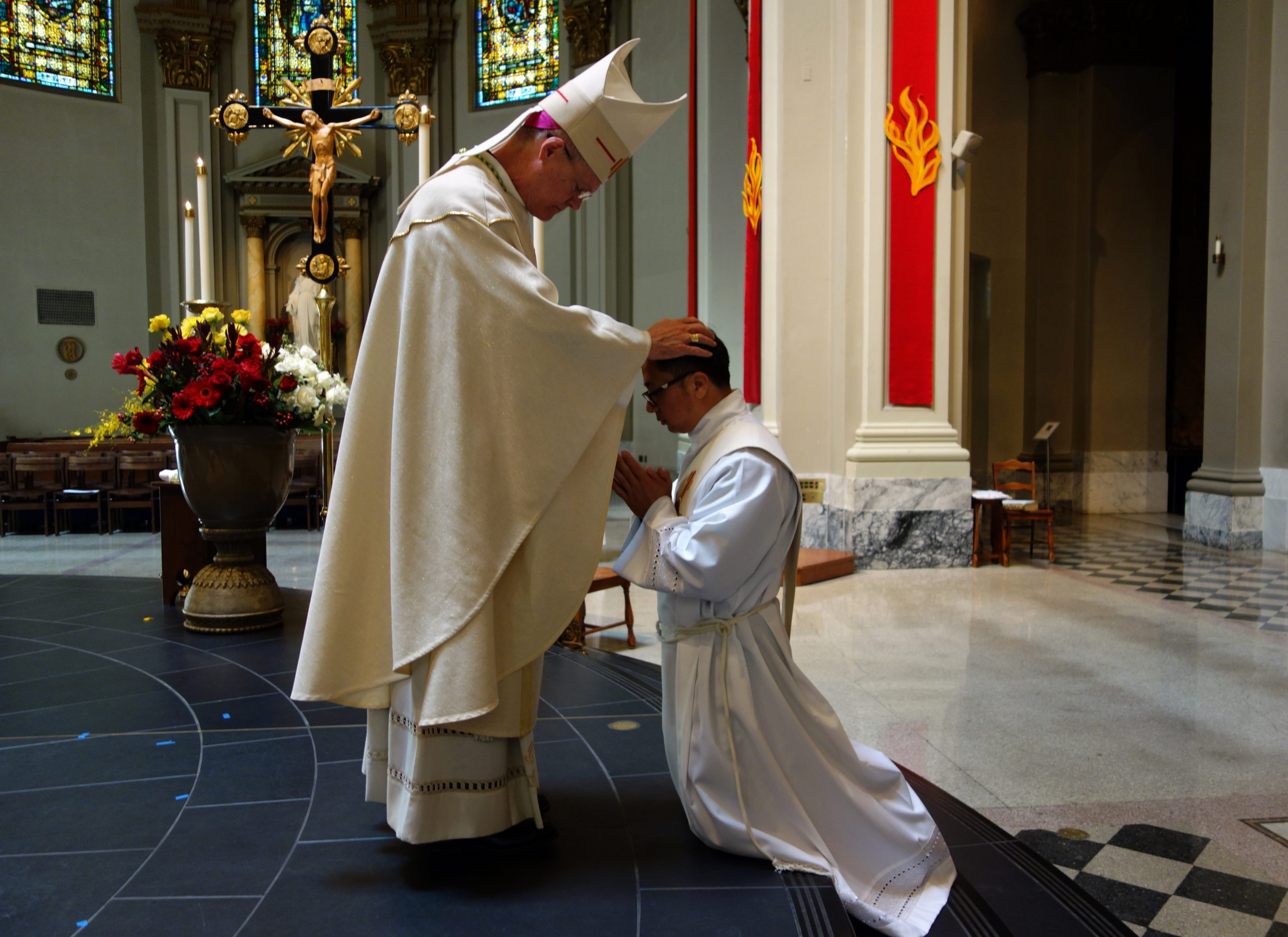The laying on of hands by Archbishop Paul D. Etienne at the Ordination Rite of Thomas Tran, June 6, 2020 at St. James Cathedral, Seattle. Photo by M. Laughlin