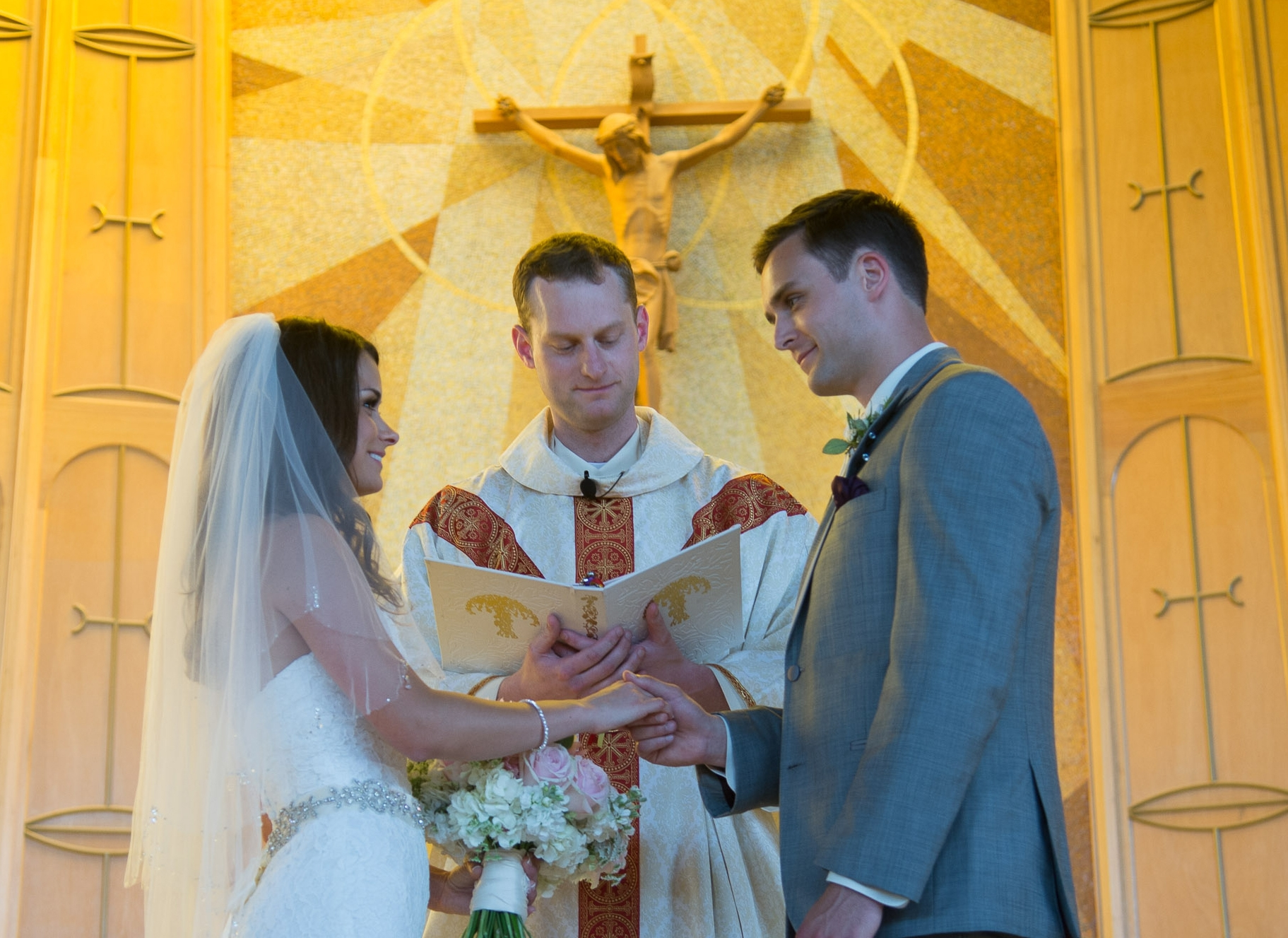 Bryce and Johnna Comfort's wedding, July 26th, 2013 at St. Charles Borromeo in Tacoma. marriage, crucifix, priest.
