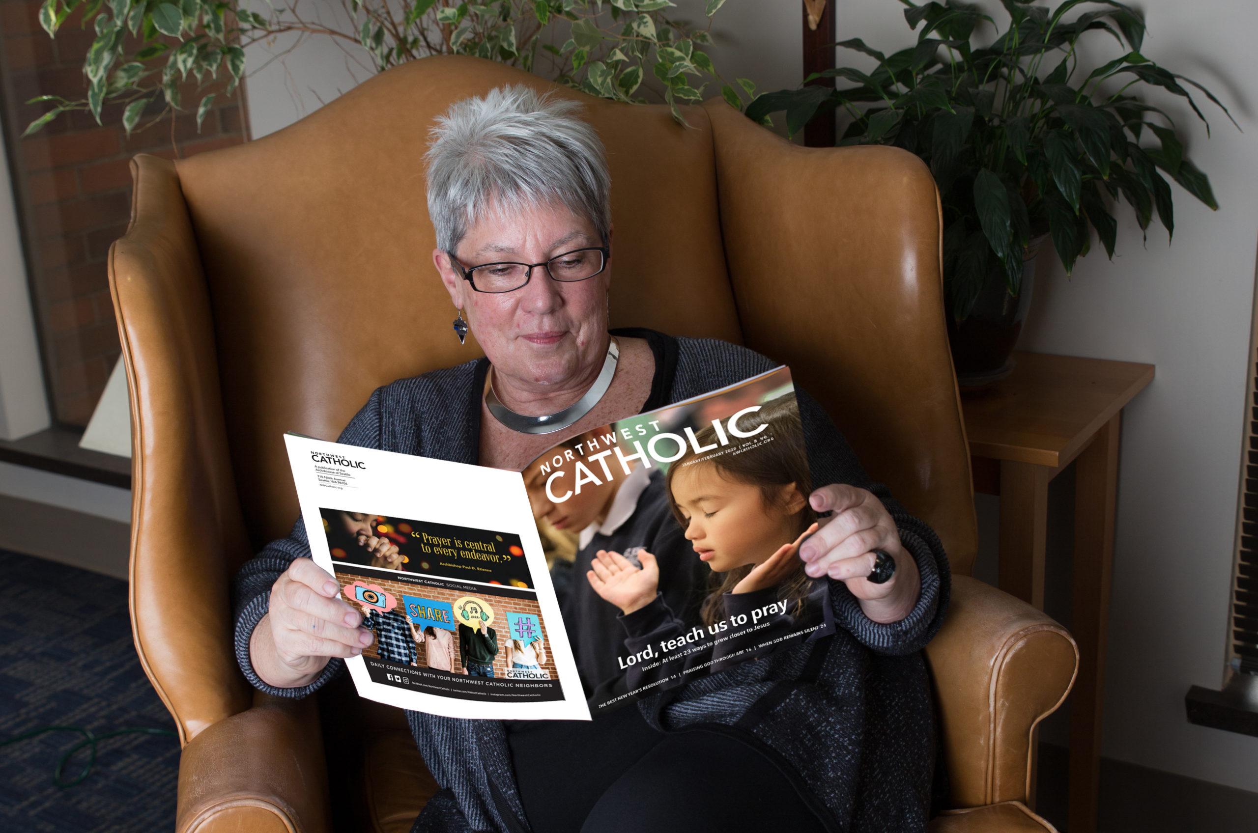 Leahy Kathleen (Kit), Chancery staff, reading Northwest Catholic Magazine NWC at the Chancery. Photo by Janis Olson Photography.