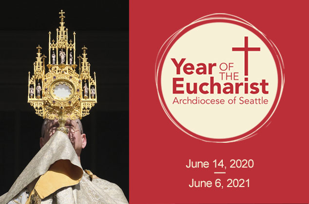 Year of the Eucharist image for home page.  Archbishop Etienne holding monstrance, blessed sacrament