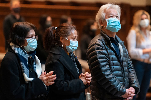 People attending mass with masks